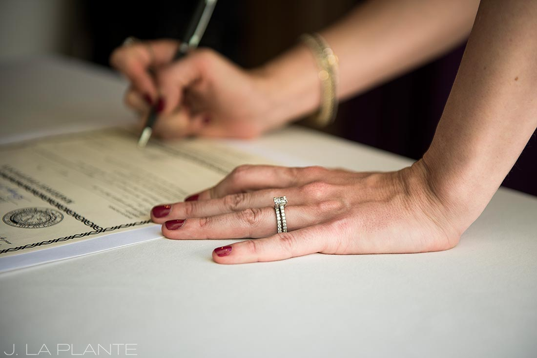 Sonnenalp Wedding | Bride signing marriage license | Vail wedding photographer | J La Plante Photo