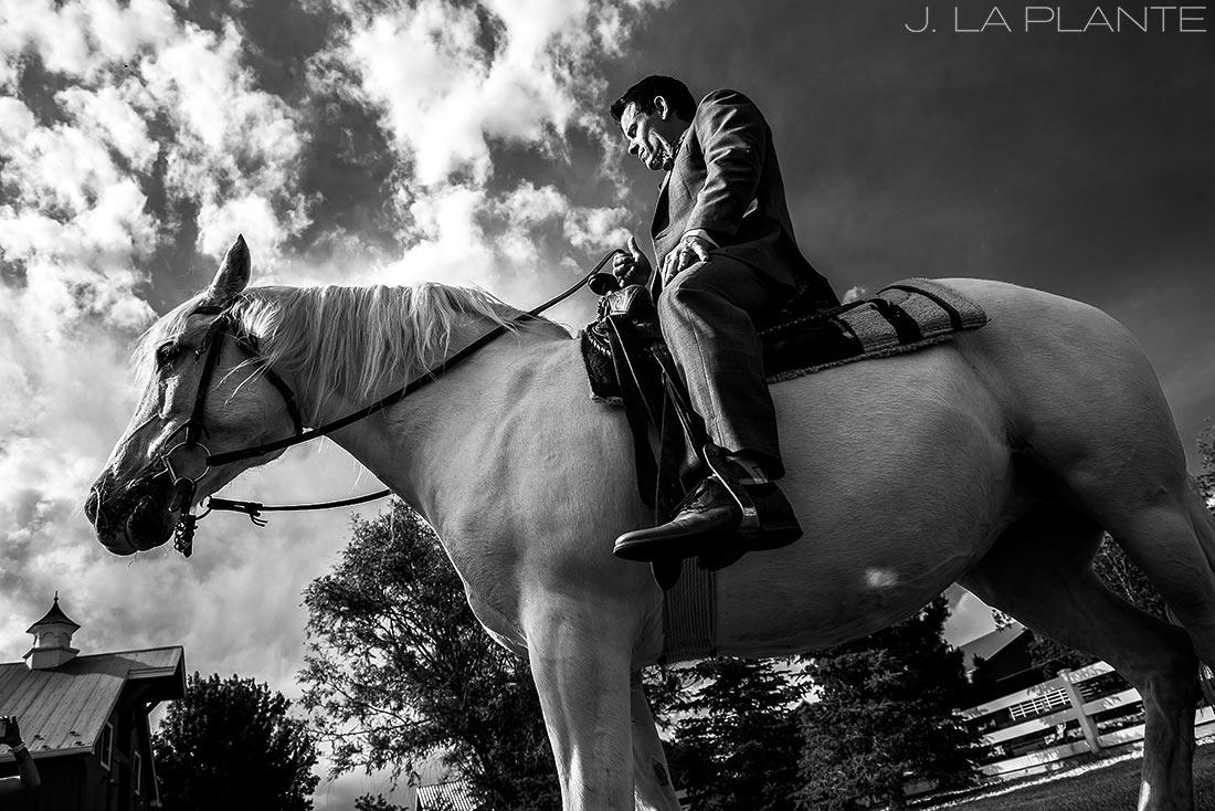 Groom on a horse | Crooked Willow Farms Wedding | Denver Wedding Photographer | J La Plante Photo
