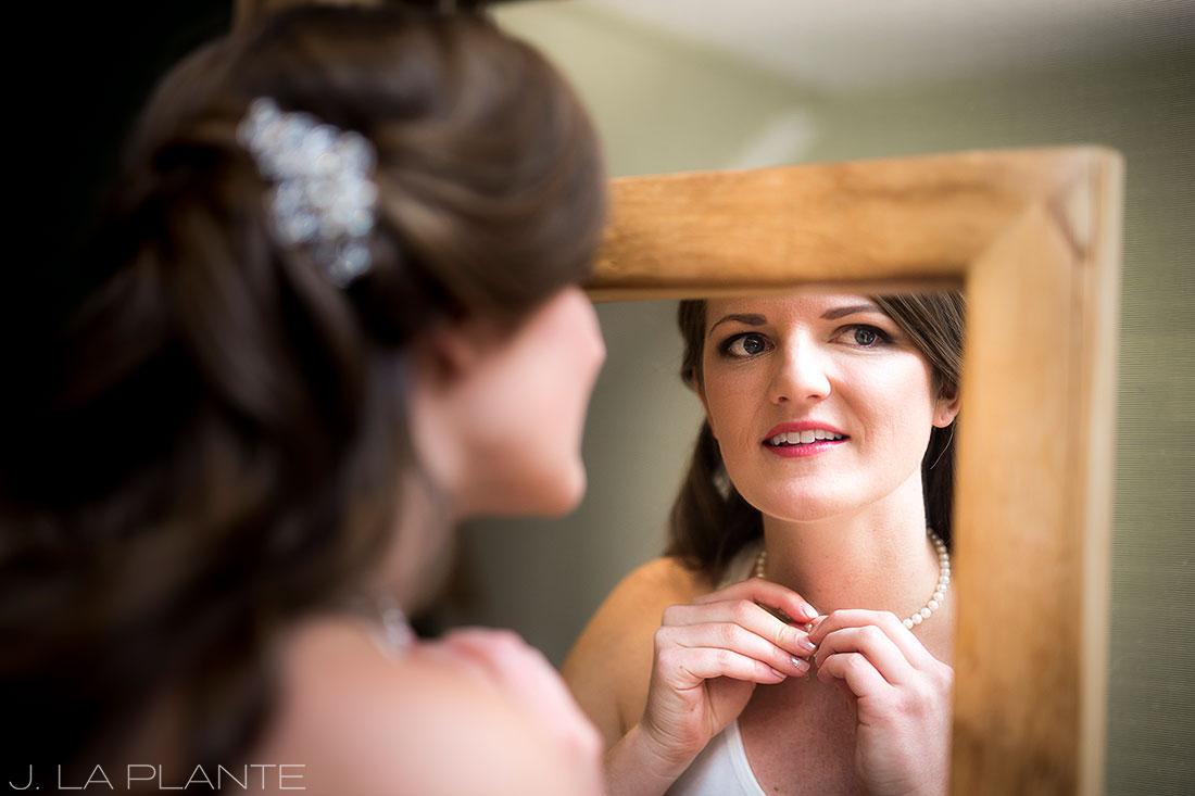 Edgewood Inn Wedding | Colorado Springs Wedding Photographer | Bride putting necklace on | J La Plante Photo