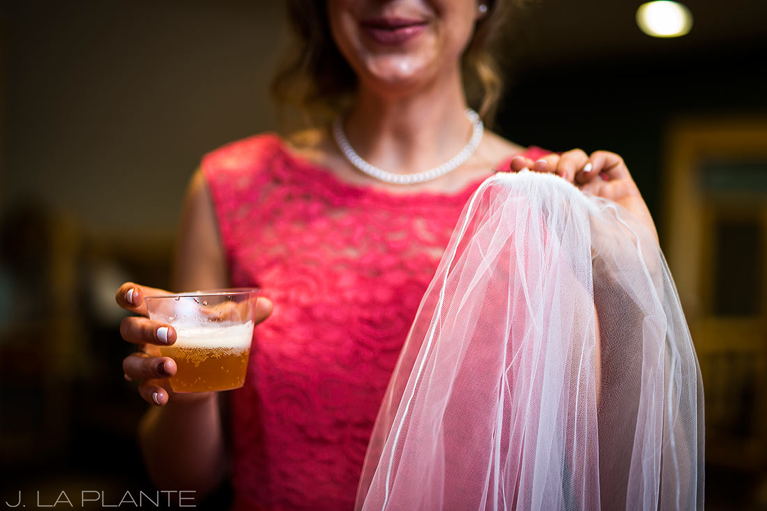 Edgewood Inn Wedding | Colorado Springs Wedding Photographer | Bridesmaid with veil and champagne | J La Plante Photo