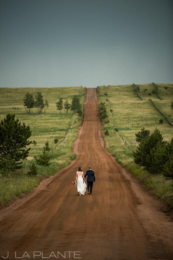 Edgewood Inn Wedding | Colorado Springs Wedding Photographer | Bride and groom walking down road | J La Plante Photo