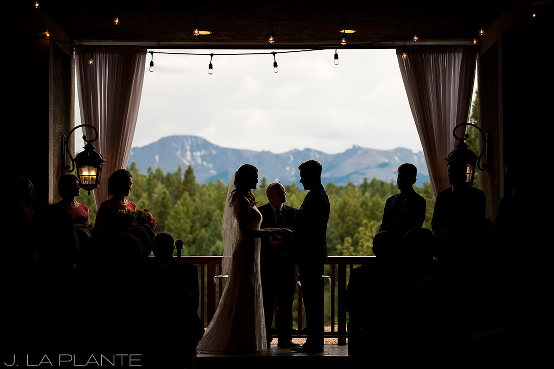 silhouette photo of bride and groom during ceremony