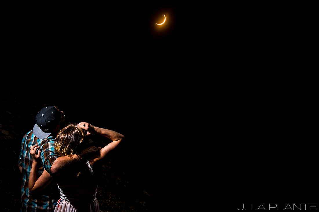 Solar eclipse engagement shoot | Couple watching solar eclipse | Vail engagement photographer | J La Plante Photo
