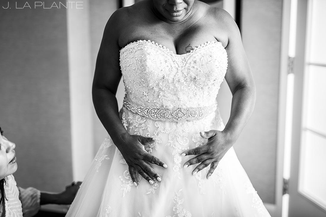 JW Marriott Cherry Creek Wedding | Bride getting into dress | Denver wedding photographer | J La Plante Photo