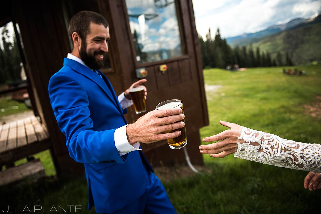 Purgatory Resort wedding | Groom handing bride a beer | Colorado wedding photographer | J La Plante Photo