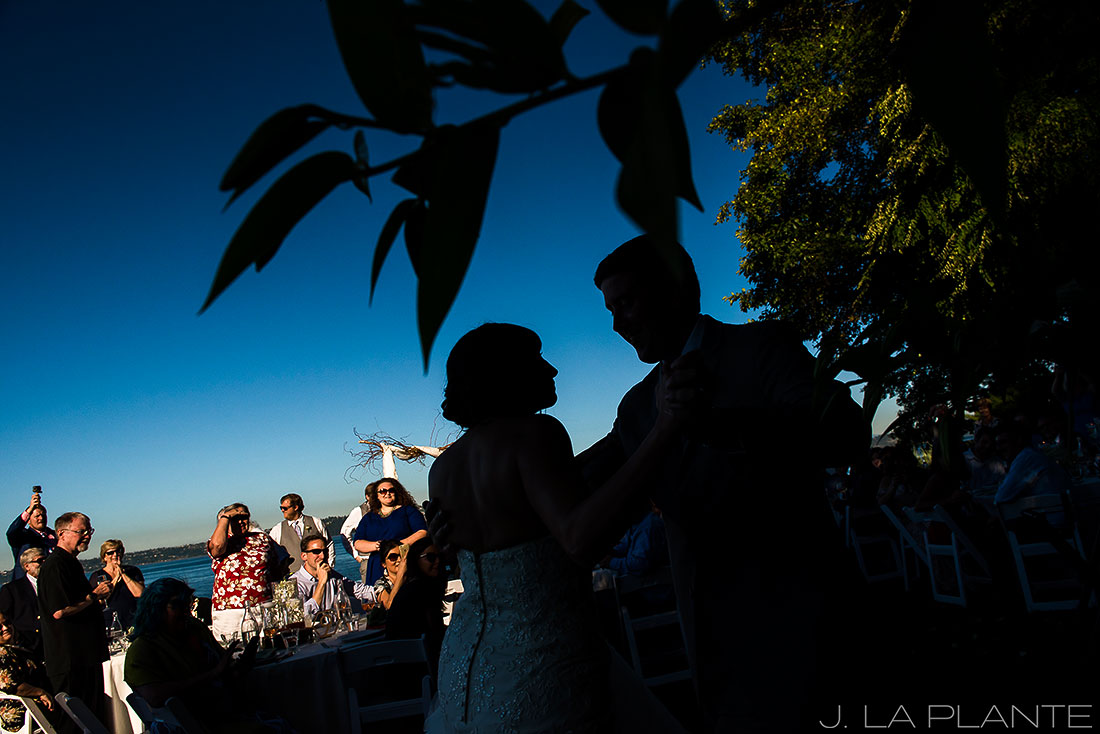 silhouette photo of bride and groom at wedding reception