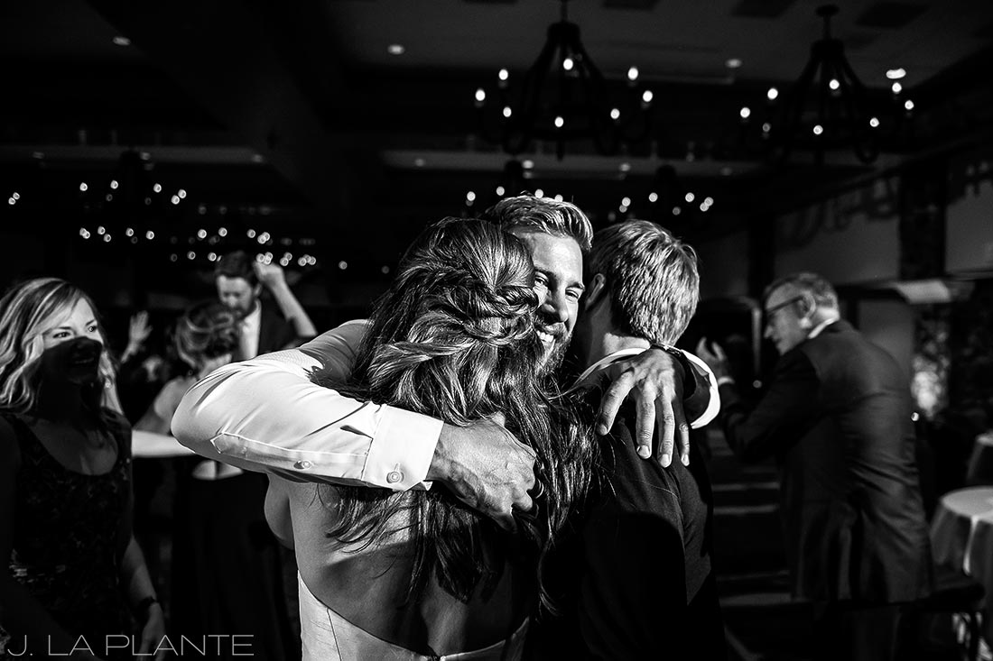 Park Hyatt Wedding | Bride and groom hugging guest | Beaver Creek wedding photographer | J La Plante Photo