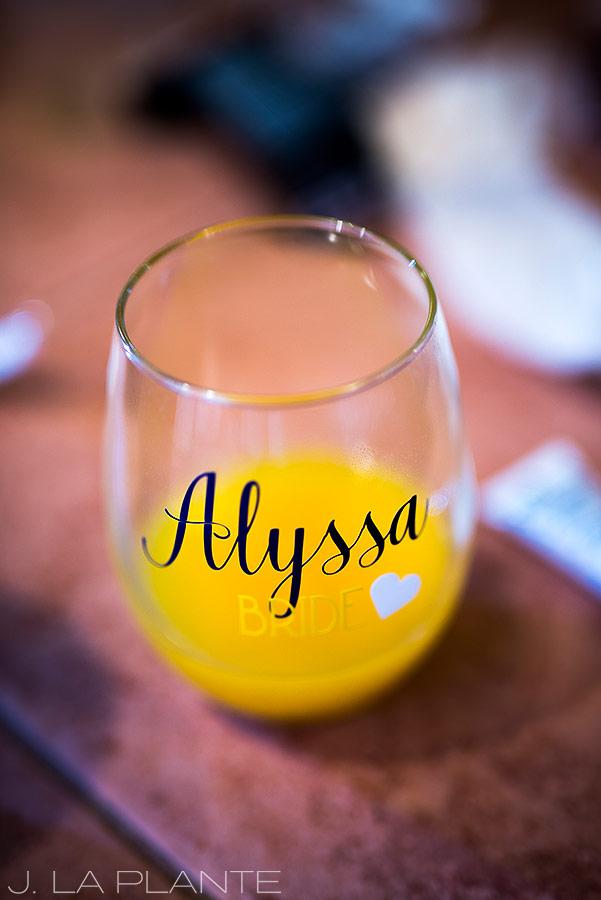 Crooked Willow Farms Wedding   Bride mimosa glass   Colorado Wedding Photographer   J La Plante Photo