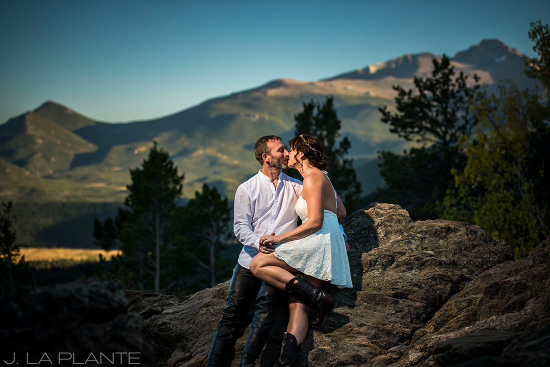 Rocky Mountain National Park Elopement | Bride and groom sitting on rocks | Colorado Elopement Photographer | J La Plante Photo