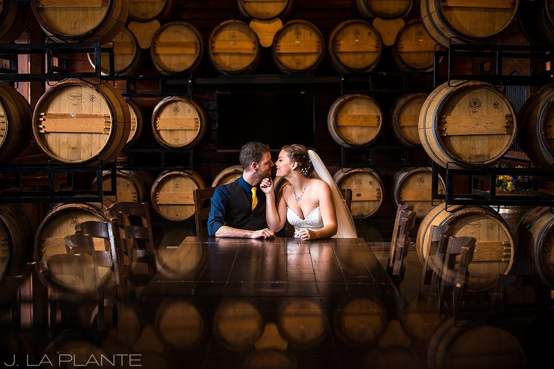 Crooked Willow Farms Wedding   Bride and groom in wine cellar   Colorado Wedding Photographer   J La Plante Photo