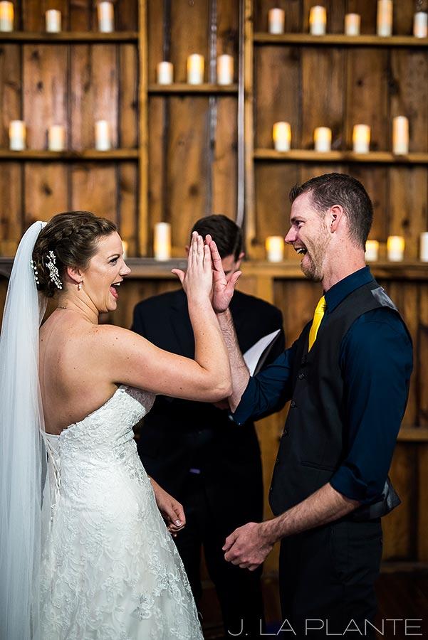 Crooked Willow Farms Wedding   Bride and groom high fiving   Colorado Wedding Photographer   J La Plante Photo