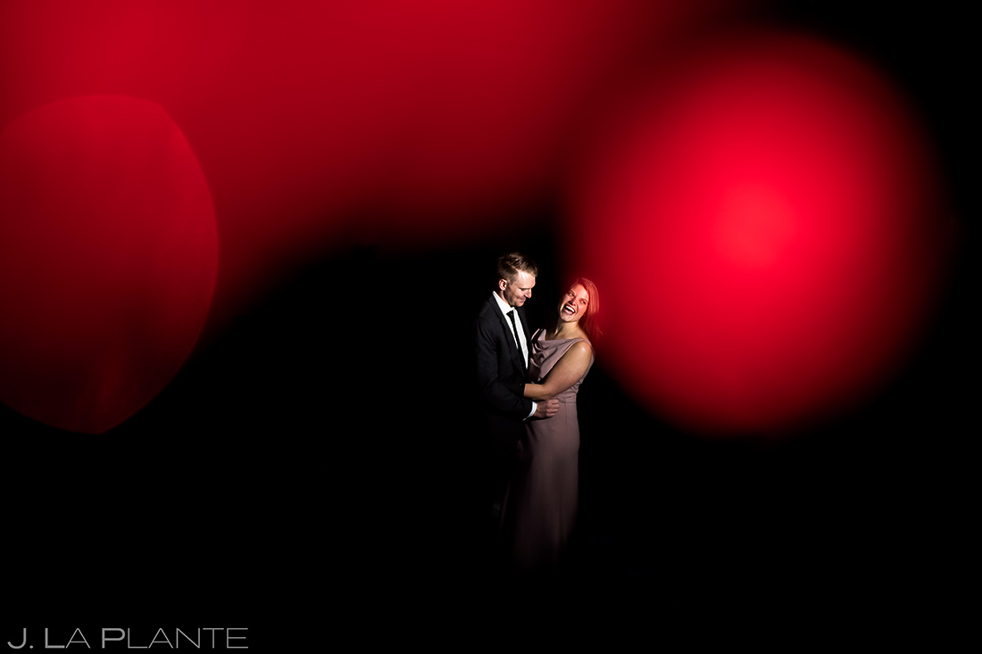 bride and groom portrait with christmas lights