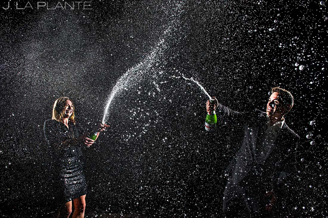 Bride and Groom Spraying Champagne | Classy Urban Engagement | Denver Wedding Photographers | J. La Plante Photo