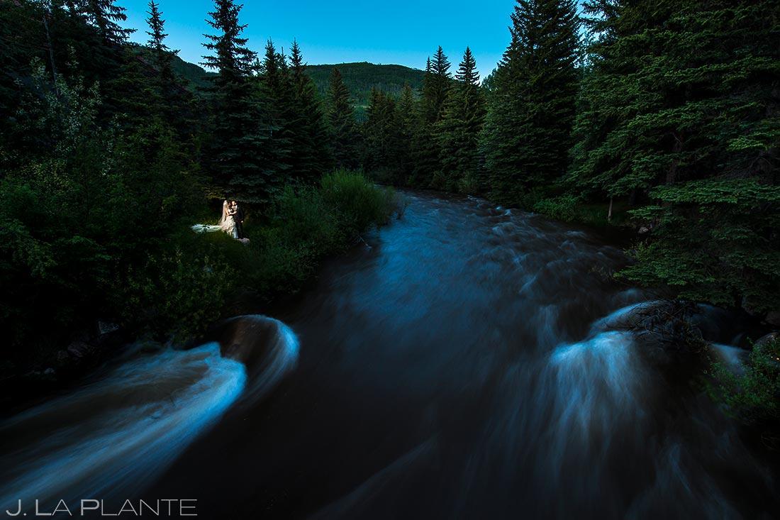 Bride and Groom by River | Sonnenalp Hotel Wedding | Vail Wedding Photographers | J. La Plante Photo