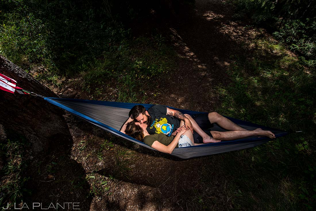 Bride and Groom Kissing in Hammock | Rustic Camping Engagement | Vail Wedding Photographers | J. La Plante Photo