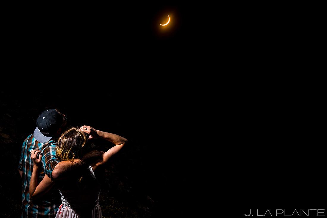 Bride and Groom Watching Eclipse | Solar Eclipse Engagement | Vail Wedding Photographers | J. La Plante Photo