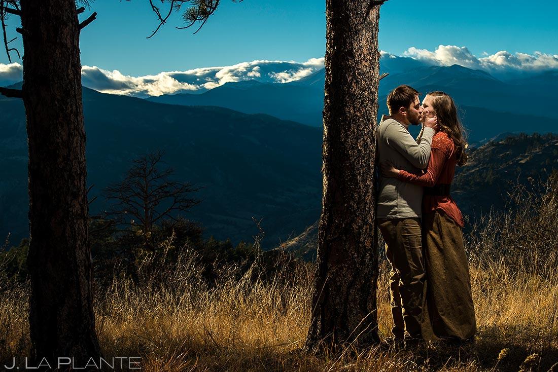 Bride and Groom Kissing on Mountain | Rustic Mountain Engagement | Estes Park Wedding Photographer | J. La Plante Photo