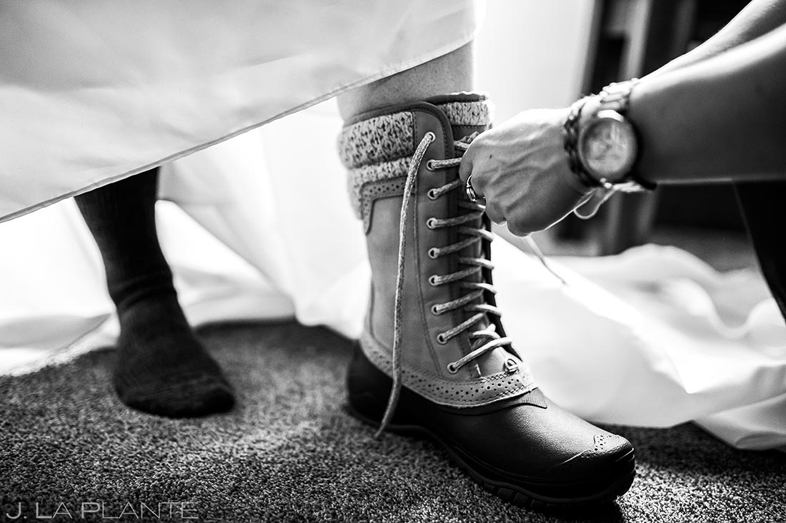 Bride wearing snowboots | Black Canyon Inn Winter Wedding | Rocky Mountain Wedding Photographer | J La Plante Photo