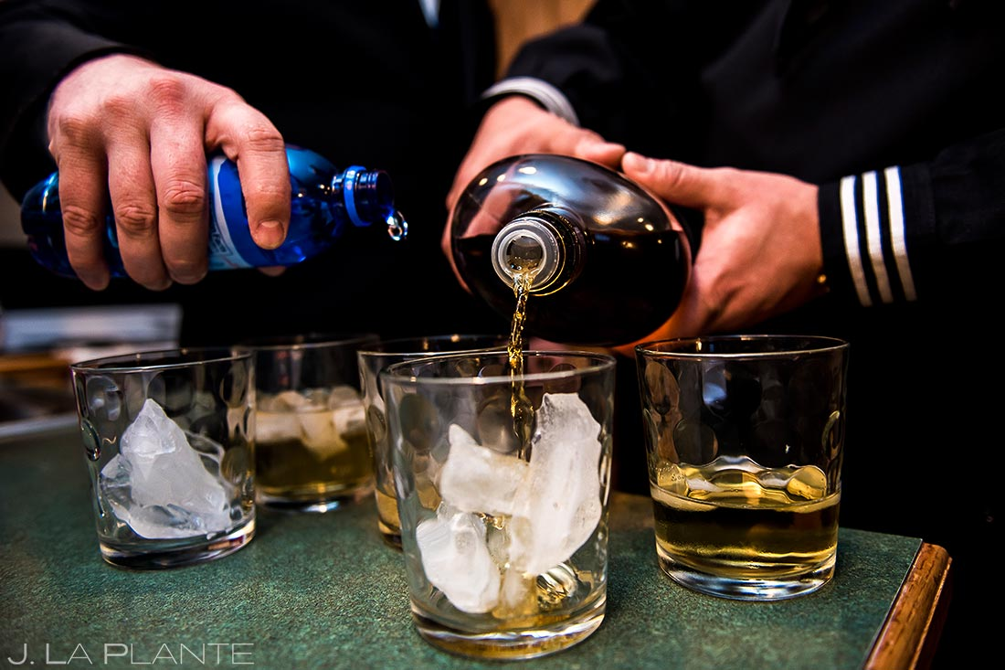 Groomsmen pouring drinks | Black Canyon Inn Winter Wedding | Rocky Mountain Wedding Photographer | J La Plante Photo