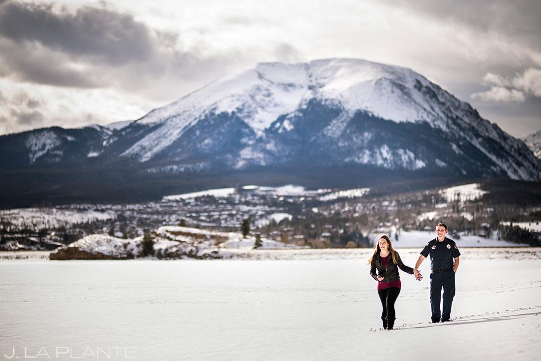 Bride and Groom on Frozen Lake | Fireman Themed Engagement | Dillon Reservoir Engagement | Colorado Wedding Photographer | J. La Plante Photo