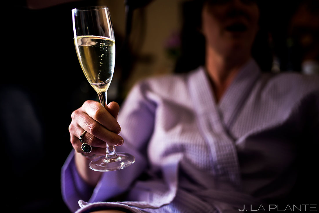 Bride drinking champagne   Evergreen Lake House Wedding   Evergreen Wedding Photographer   J. La Plante Photo