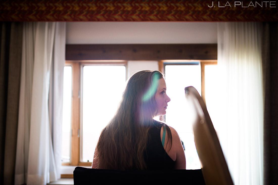 Bridesmaid getting ready | Evergreen Lake House Wedding | Evergreen Wedding Photographer | J. La Plante Photo