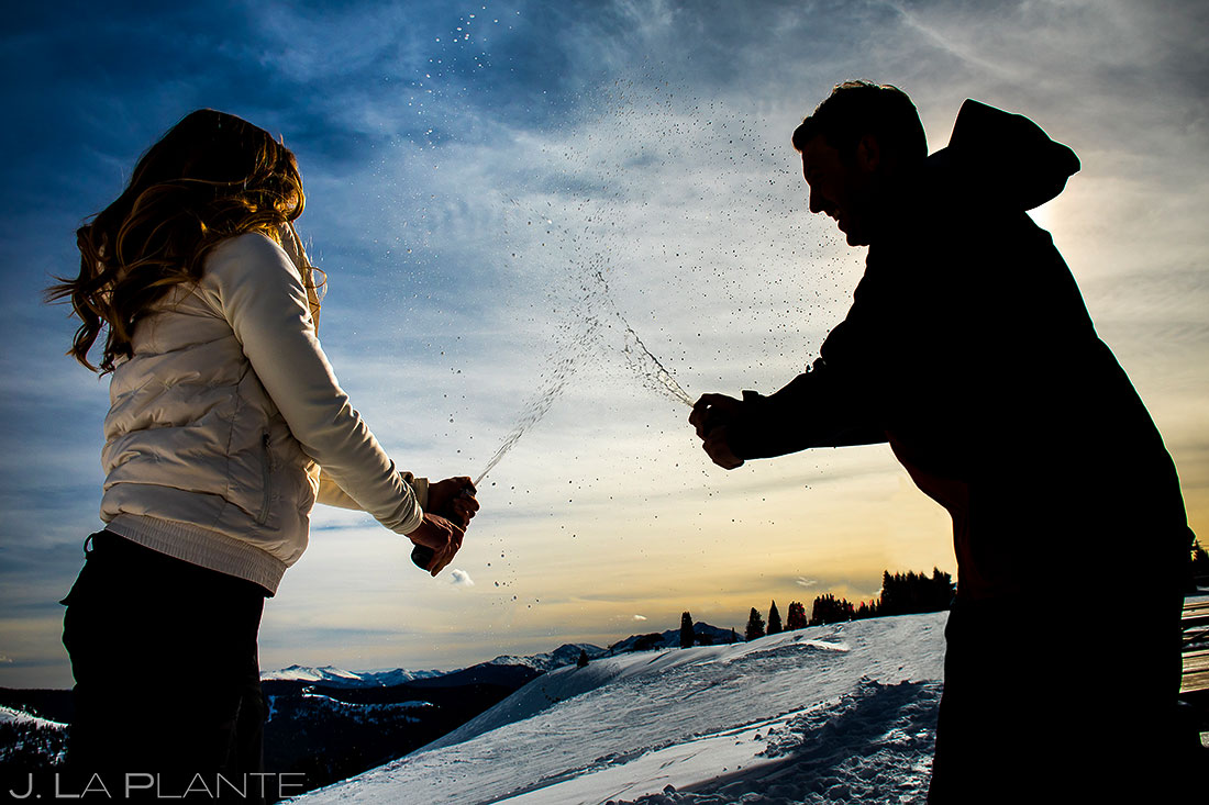 Vail Ski Engagement | Couple popping champagne | Vail wedding photographer | J. La Plante Photo