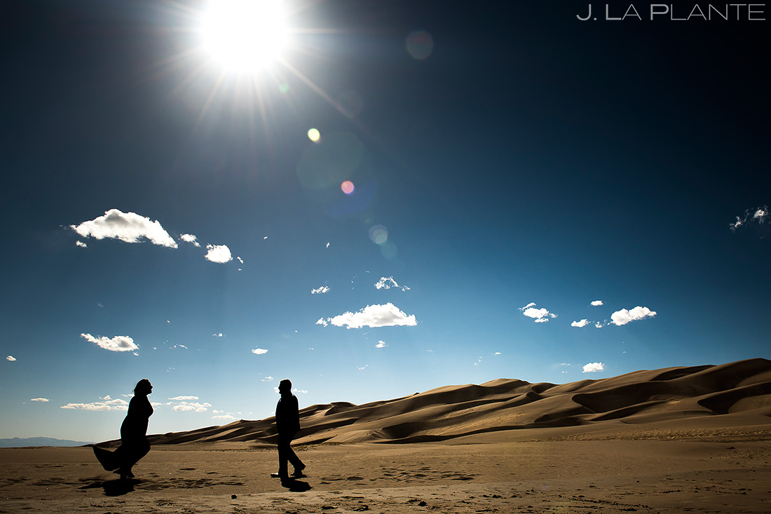 great sand dunes engagement bride and groom silhouette