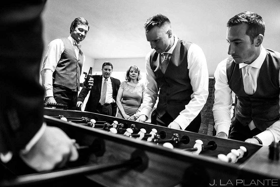 Groomsmen Playing Foosball | Wedgewood Boulder Creek Wedding | Boulder Wedding Photographer | J. La Plante Photo
