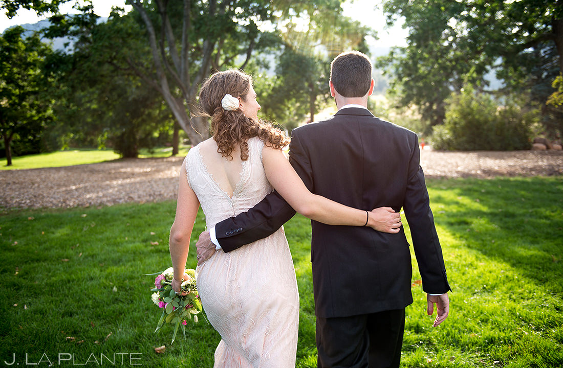 Bride and Groom Walking Through Park   Chautauqua Park Wedding   Boulder Wedding Photographer   J. La Plante Photo
