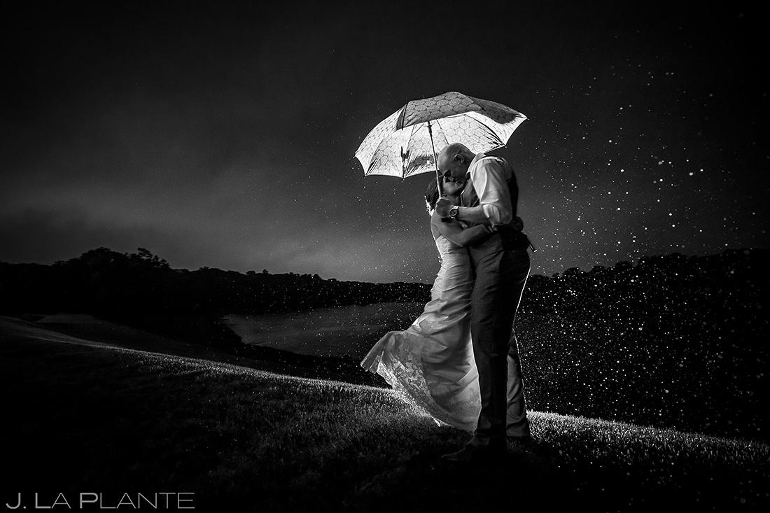 Bride and Groom Kissing in the Rain   Kalamazoo Country Club Wedding   Destination Wedding Photographer   J. La Plante Photo