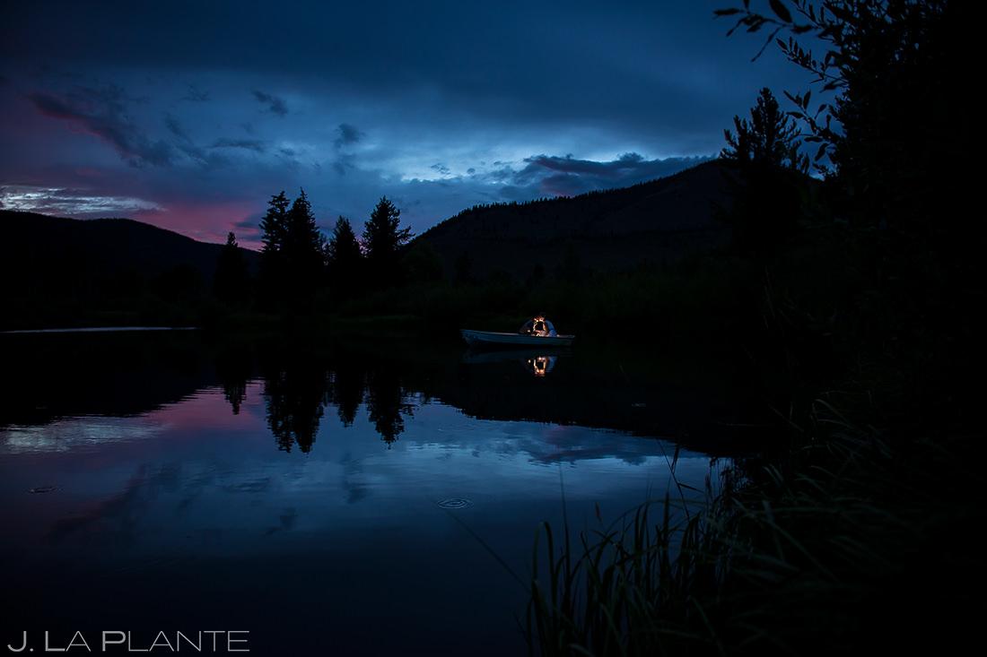 Bride and Groom Riding in Boat   Shadow Mountain Guest Ranch Wedding   Colorado Wedding Photographer   J. La Plante Photo