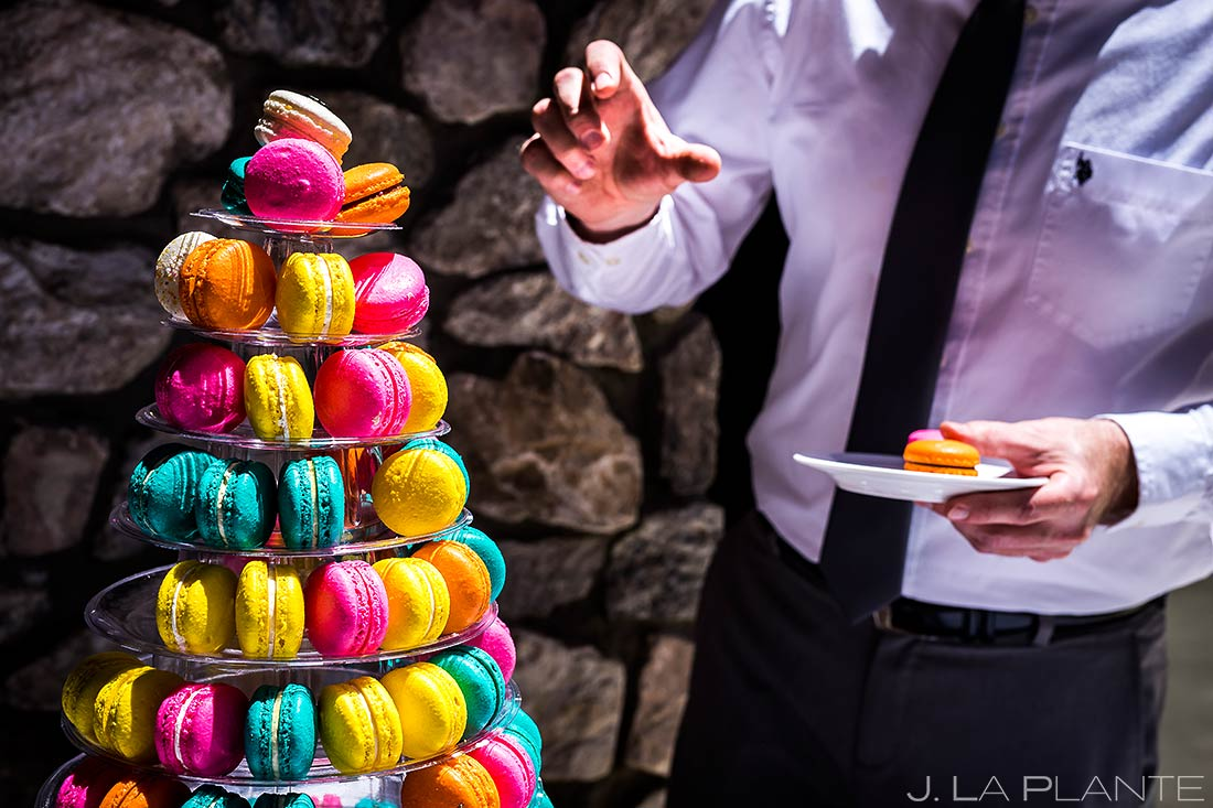 Wedding Guest Eating Macaroons | Revolution Dining Wedding Reception | Beaver Creek Lodge Wedding | Beaver Creek Wedding Photographer | J. La Plante Photo