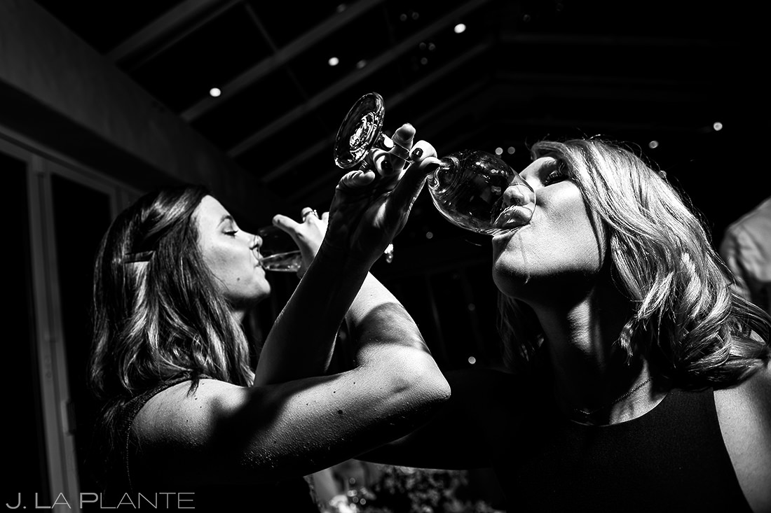 Wedding Guests Chugging Wine | Sonnenalp Hotel Wedding | Vail Wedding Photographer | J. La Plante Photo