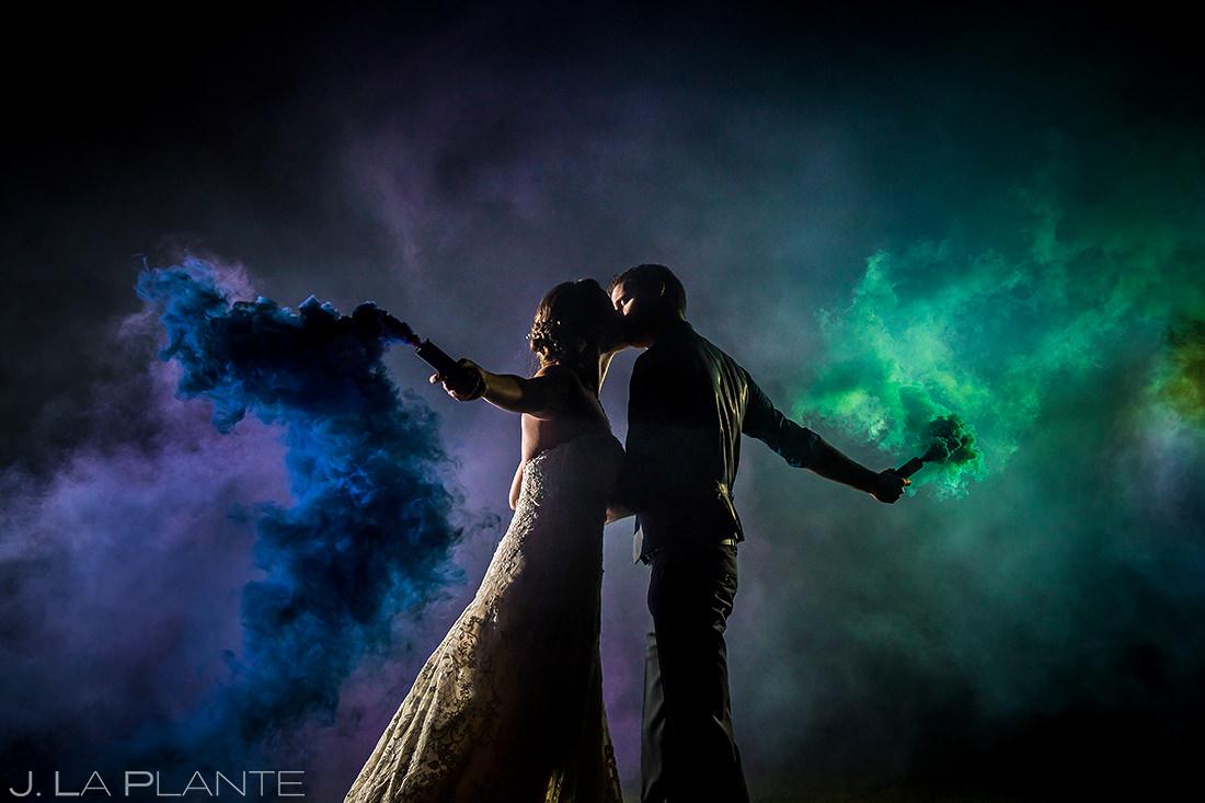 Bride and Groom Smoke Bombs Photo   Crooked Willow Farms Wedding   Colorado Wedding Photographer   J. La Plante Photo