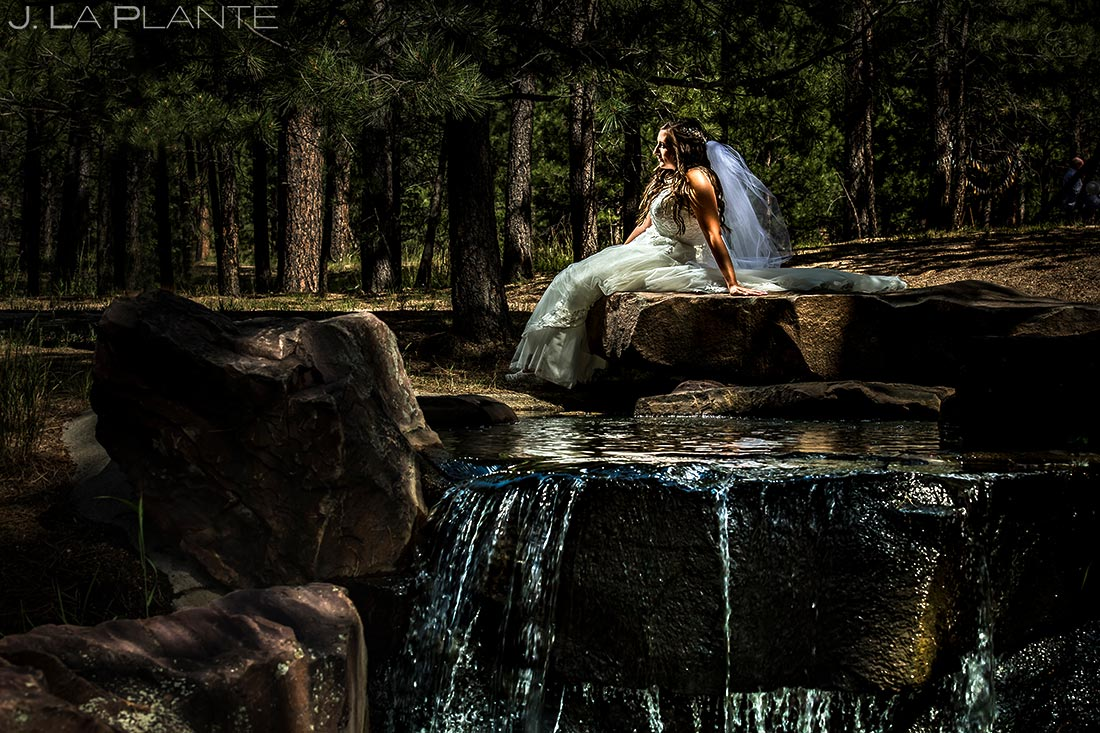 Portrait of Bride by Waterfall | Lodge at Cathedral Pines Wedding | Colorado Springs Wedding Photographer | J. La Plante Photo