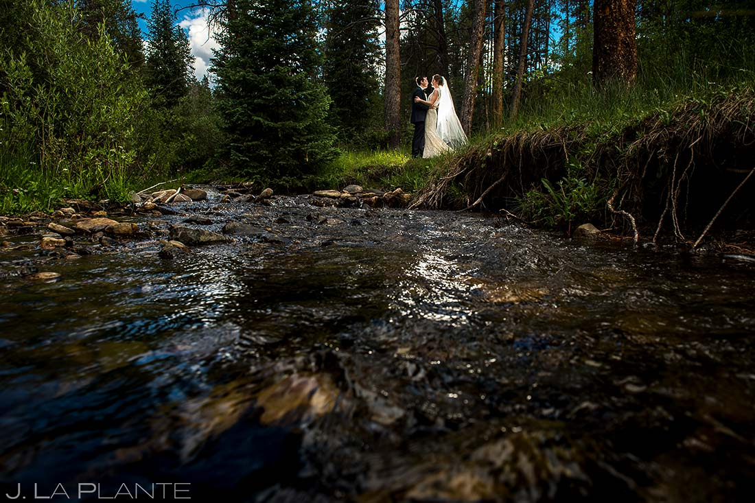 Bride and Groom Portrait by River | Camp Hale Wedding | Vail Wedding Photographer | J. La Plante Photo