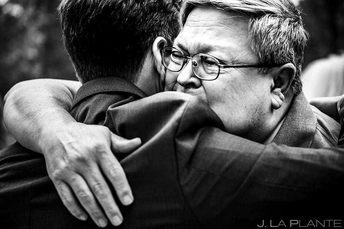 Groom Hugging Father | Lodge at Cathedral Pines Wedding | Colorado Springs Wedding Photographer | J. La Plante Photo