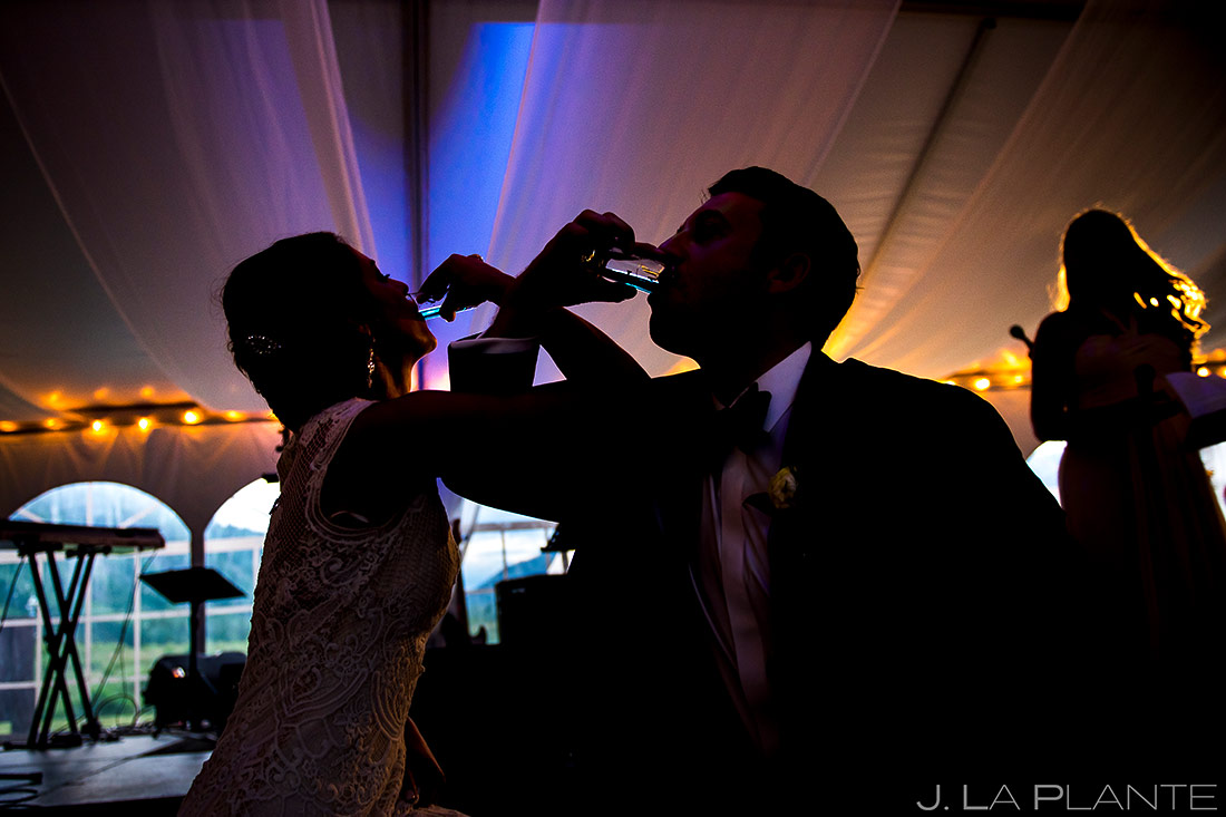 Bride and Groom Doing Shots | Camp Hale Wedding | Vail Wedding Photographer | J. La Plante Photo
