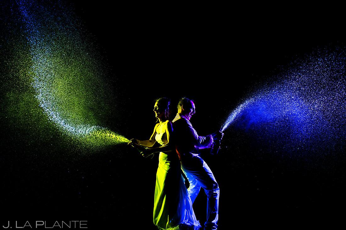 Bride and Groom Spraying Champagne | Chautauqua Park Wedding | Boulder Wedding Photographer | J. La Plante Photo