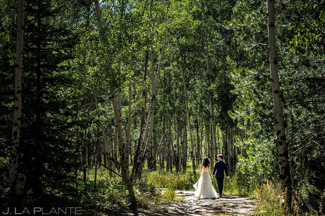 Bride and Groom Hiking in Woods | Dao House Wedding | Estes Park Wedding Photographer | J. La Plante Photo