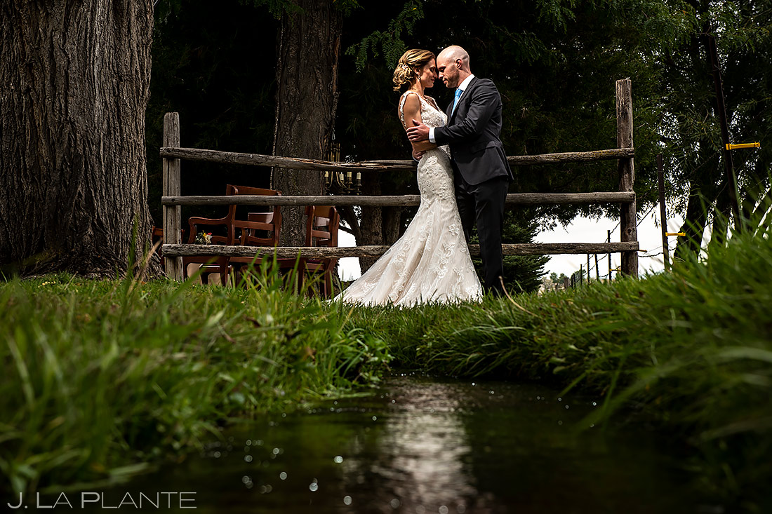 Bride and Groom by Creek | Shupe Homestead Wedding | Boulder Wedding Photographer | J. La Plante Photo