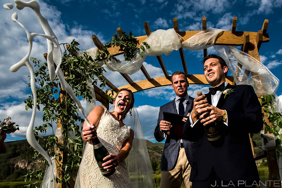 Bride and Groom Spraying Champagne | Camp Hale Wedding | Vail Wedding Photographer | J. La Plante Photo
