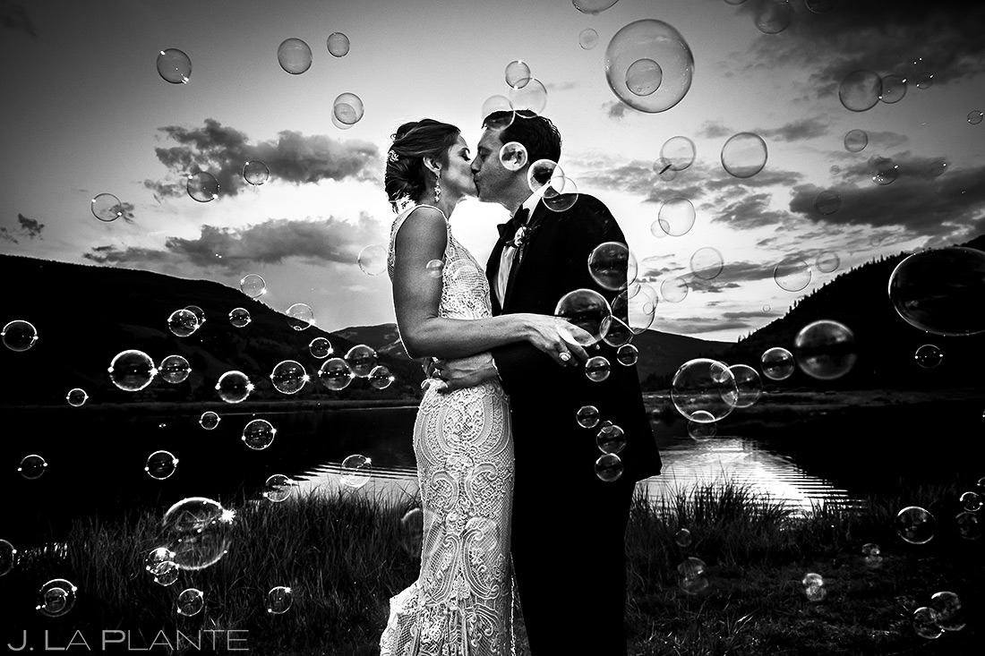 Bride and Groom Blowing Bubbles | Camp Hale Wedding | Vail Wedding Photographer | J. La Plante Photo