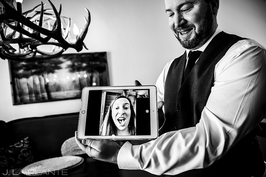 Groom Skyping with Sister | Sonnenalp Club Wedding | Beaver Creek Wedding Photographer | J. La Plante Photo