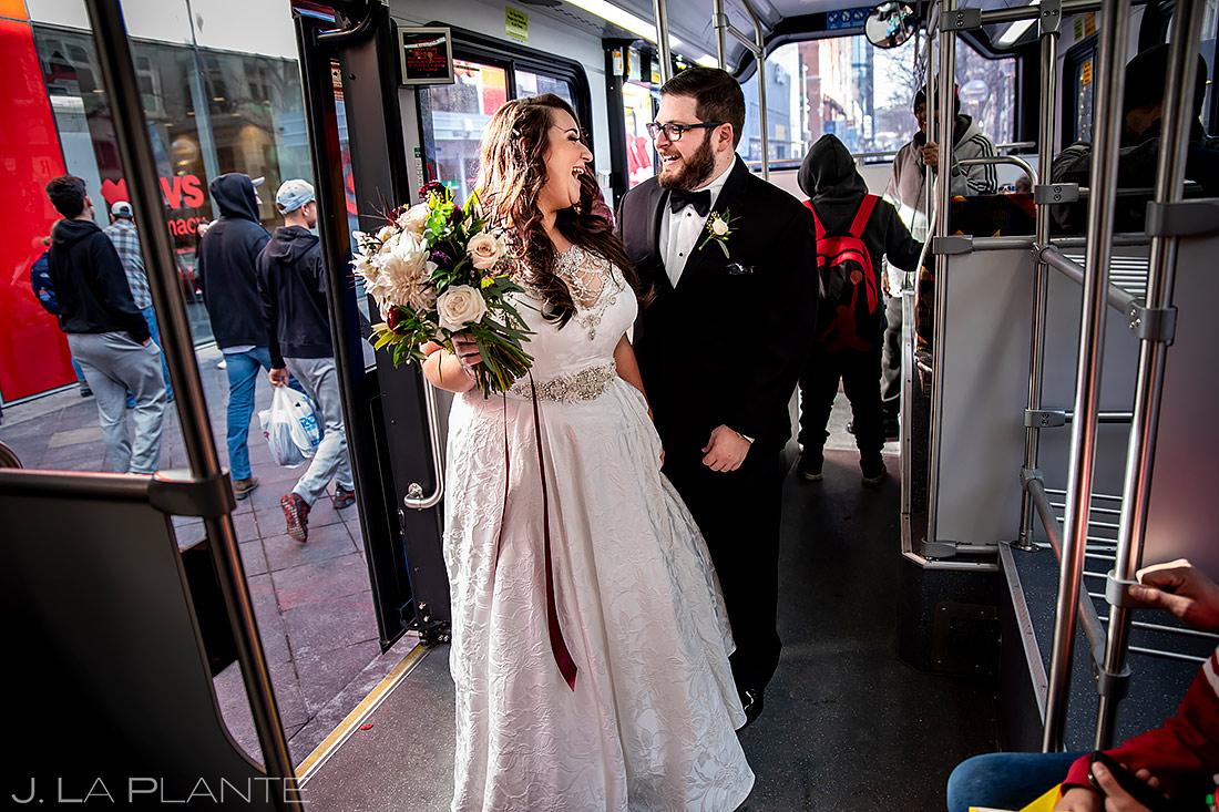 Bride and Groom Riding 16th Street Mall Bus | Downtown Denver Wedding | Denver Wedding Photographer | J. La Plante Photo