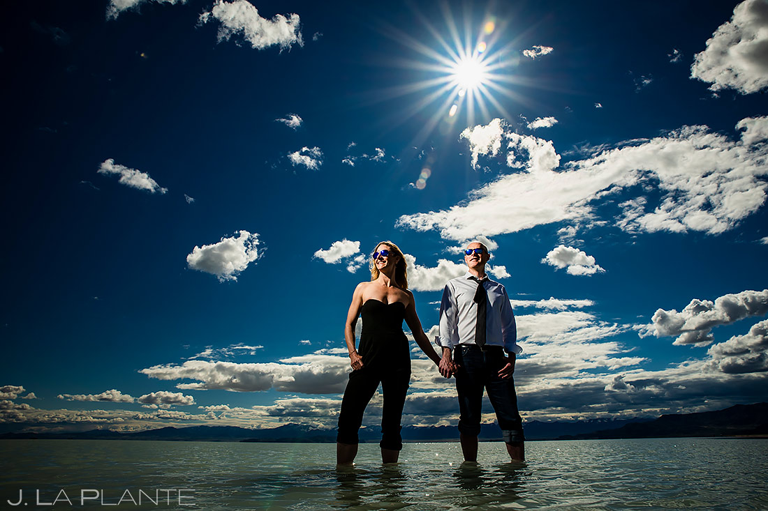 Bride and Groom Wading in Water | Bonneville Salt Flats Engagement | Destination Wedding Photographer | J. La Plante Photo