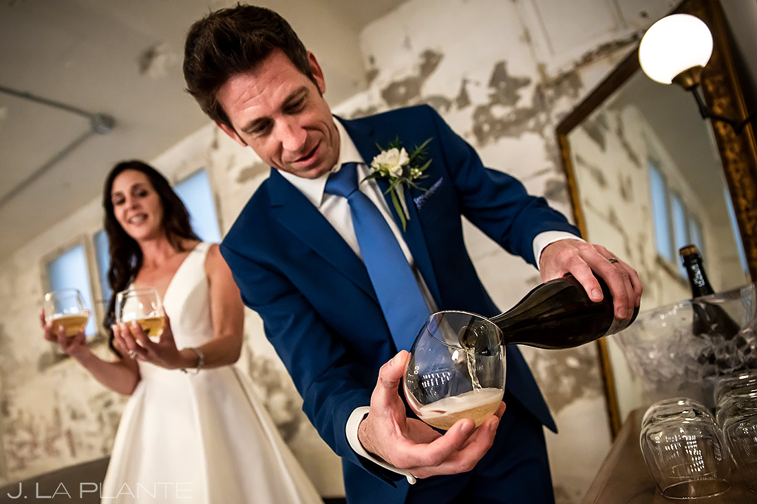 Bride and Groom Popping Bottles | St Vrain Wedding | Boulder Wedding Photographer | J. La Plante Photo