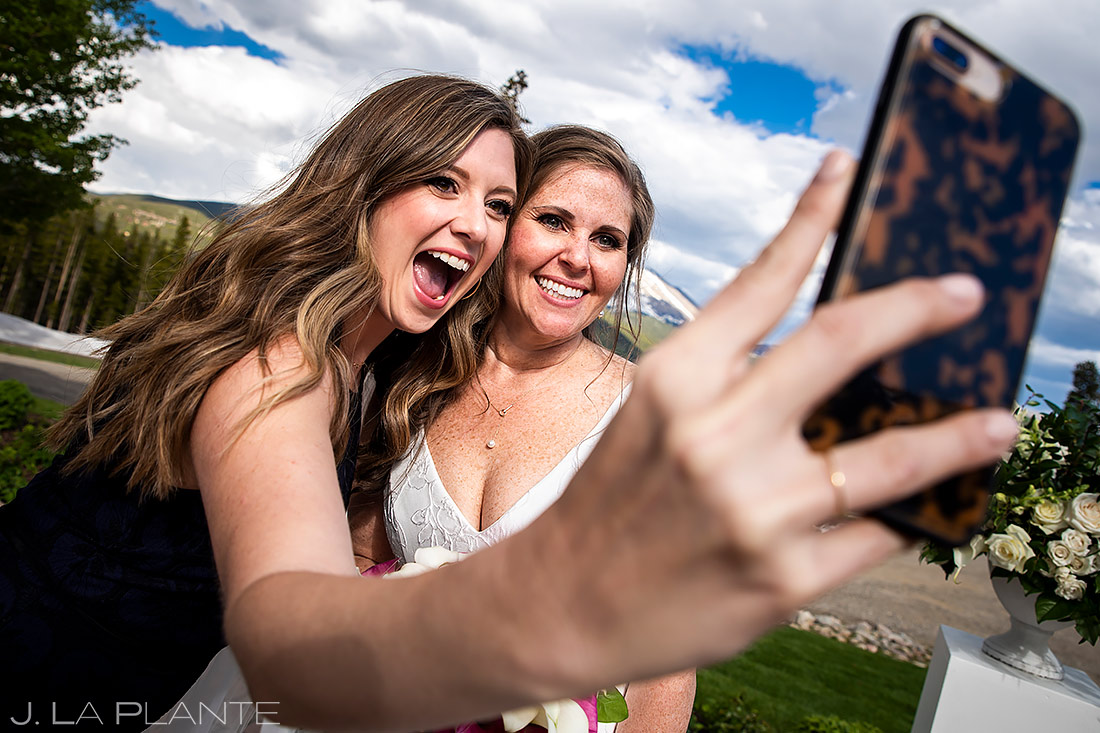 Bride Taking Selfies | Tenmile Station Wedding | Breckenridge Wedding Photographer | J. La Plante Photo