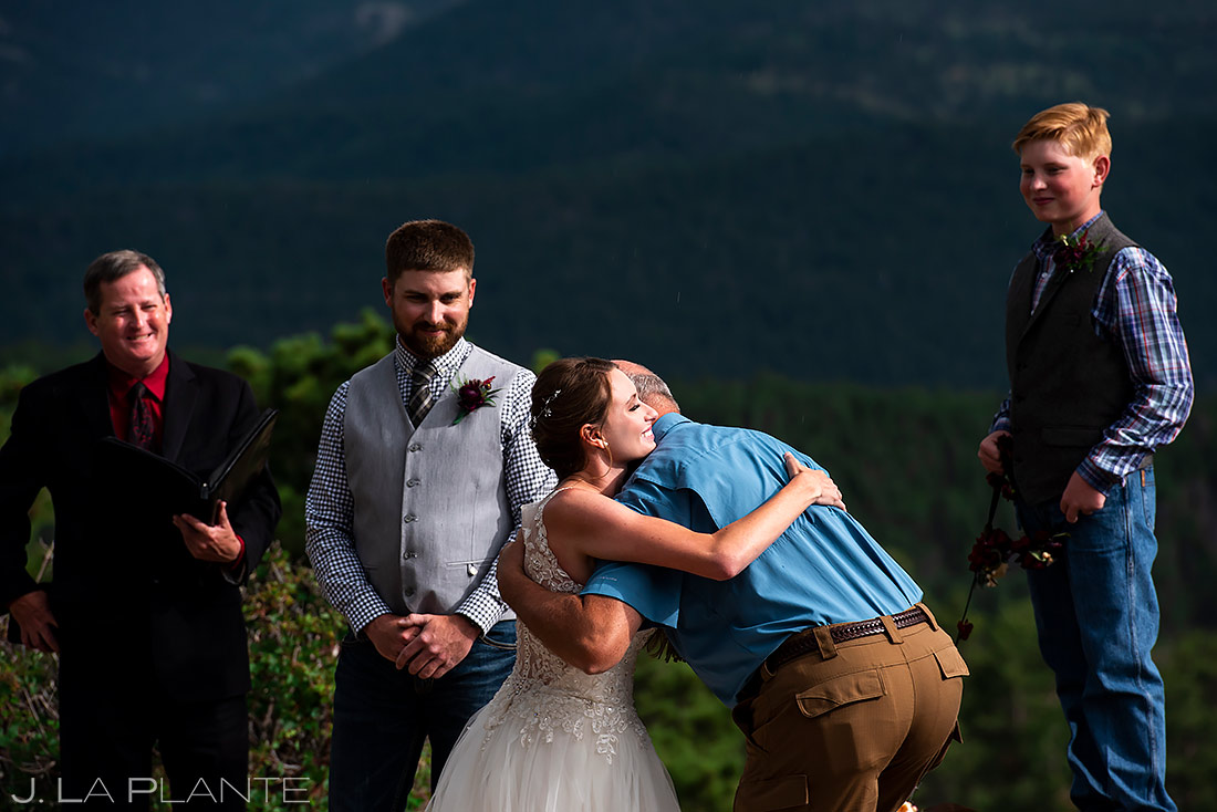 Bride Hugging Father | 3M Curve Wedding | Rocky Mountain National Park Wedding Photographer | J. La Plante Photo
